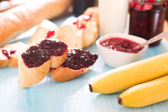 Breakfast baguette with jam and berries Royalty Free Stock Photography