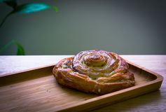 Breakfast baked roll, almods with wooden backgroud royalty free stock images