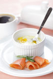 Breakfast with baked eggs and salmon Stock Image