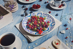 Breakfast with baked pea and berries at blue rustic wood Stock Image