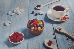 Breakfast with baked pea and berries at blue rustic wood Stock Photo