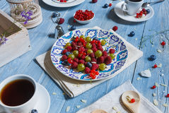 Breakfast with baked pea and berries at blue rustic wood Stock Photography