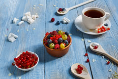 Breakfast with baked pea and berries at blue rustic wood Royalty Free Stock Photos