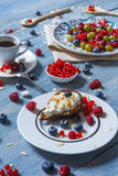 Breakfast with baked pea and berries at blue rustic wood Royalty Free Stock Image