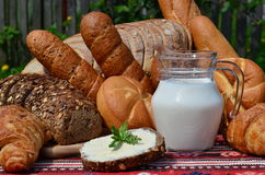 Breakfast baked rolls and fresh milk Stock Images