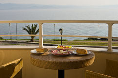 Breakfast at the balcony by the sea Royalty Free Stock Photos