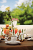Breakfast on the balcony. Table set for an outdoor breakfast stock images