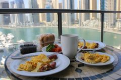Breakfast on the balcony terrace overlooking the sea and skyscrapers Royalty Free Stock Image