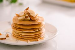 Breakfast. Banana pancakes with honey and nuts Royalty Free Stock Image