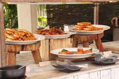 Breakfast bar buffet at restaurant. Sausage, bacon and baked tomato. Royalty Free Stock Photography