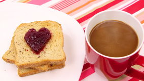 A breakfast - Be my valentine. A breakfast scene with a heart of red jam. Be my valentine stock video