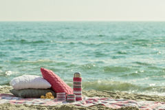 Breakfast on the beach. Coffee and croissants on the sea. Pillow Stock Images