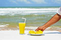 Breakfast on the beach Royalty Free Stock Image