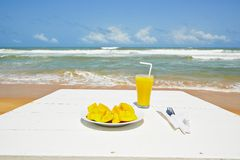 Breakfast on the beach Stock Photo