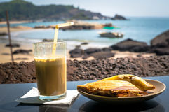 Breakfast on the beach. A sandwich and a coffee cocktail on the table in the restaurant on background of the sea Royalty Free Stock Photos