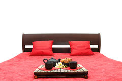 Breakfast on a bed. Tray with breakfast on a bed in a hotel room Royalty Free Stock Photography