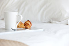 Breakfast in bed. Tray with breakfast on a bed Stock Photos