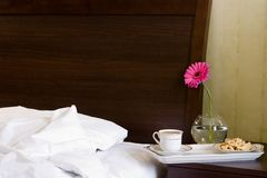 Breakfast in bed. White tray with breakfast and pink flower Royalty Free Stock Images