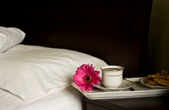 Breakfast in bed. White tray with breakfast and pink flower Royalty Free Stock Image