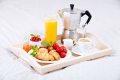 Breakfast in bed. With coffee and croissants on a tray Stock Photo