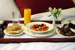 Breakfast in Bed. This is an image of a breakfast tray on a bed stock photography