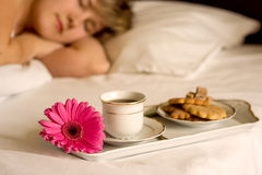 Breakfast in bed. A beautiful woman with breakfast in bed Royalty Free Stock Photos