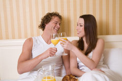 Breakfast in bed. Lovely young couple enjoying a simple breakfast in bed Royalty Free Stock Photos