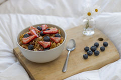 Breakfast on the bed. Breakfast with cereals and fruits in bed Stock Photos