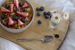 Breakfast on the bed. Breakfast with cereals and fruits in bed Stock Image