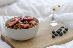 Breakfast on the bed. Breakfast with cereals and fruits in bed Royalty Free Stock Photography