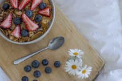 Breakfast on the bed. Breakfast with cereals and fruits in bed Royalty Free Stock Photos