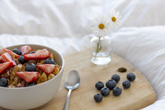 Breakfast on the bed. Breakfast with cereals and fruits in bed Stock Photo