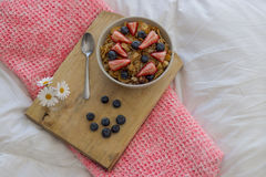 Breakfast on the bed. Breakfast with cereals and fruits in bed Stock Images