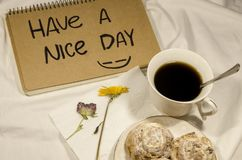Have a nice day. Breakfast in bed with coffee, biscuits and flowers. Have a nice day concept. Start your morning with a smile on your face royalty free stock photos