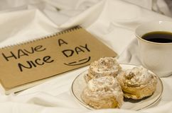 Have a nice day. Breakfast in bed with coffee, biscuits and flowers. Have a nice day concept. Start your morning with a smile on your face royalty free stock photo