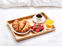 Breakfast in bed. With coffee, croissants, strawberries and juice Stock Photos