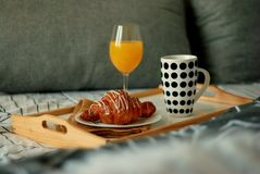 Breakfast in Bed. Coffee and Croissants White Chocolate Food. Cup of Coffe or Tea. Morning light. Royalty Free Stock Photography