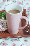 Breakfast in bed. Coffee with milk in a pink circle on a wooden tray Royalty Free Stock Image