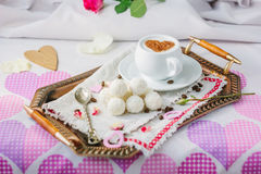 Breakfast in bed on copper tray over bed linens. Breakfast in bed on copper tray over bed linens Stock Photography