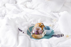 Breakfast in bed. Enjoying a good cup of tea in the morning, teapot of flower tea with Fresh croissants on a plate . Valentine`s day breakfast in bed, Mother`s Royalty Free Stock Image