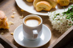 Breakfast in bed with espresso, flower and croissant Royalty Free Stock Photo
