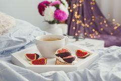 Breakfast in bed: fig toast and coffee. Close-up royalty free stock photo