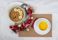 Breakfast in bed with flowers and a card stock photo