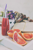 Breakfast in bed with fresh juice and grapefruit. Royalty Free Stock Photography