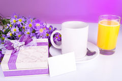 Breakfast in bed with gift and juice Royalty Free Stock Image