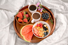 Breakfast in bed. Healthy food and coffee on tray Stock Photography