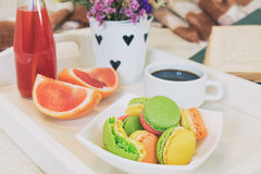 Breakfast in bed with hot coffee and macaroons. Stock Images
