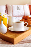 Breakfast on a bed in a hotel room Stock Photos