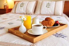 Breakfast on a bed in a hotel room Royalty Free Stock Photography