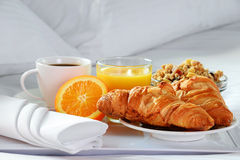 Breakfast in bed in hotel room. Stock Photo